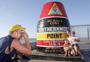 Kevin Lazarski of Dover, Wisc., photographs his wife, Dina, and sons, Jacob and Jordan, at the Southernmost Point marker in Key West, Fla. The icon is one of the most photographed landmarks in the Florida Keys and delineates the area in Key West as the southernmost point in the continental United States. Photo by Rob O'Neal/Florida Keys News Bureau